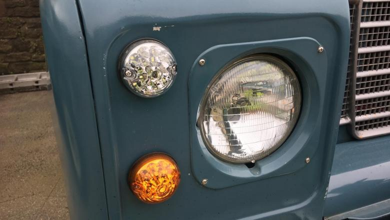 The front lamps on a series 3 Land rover fitted with LED lamps