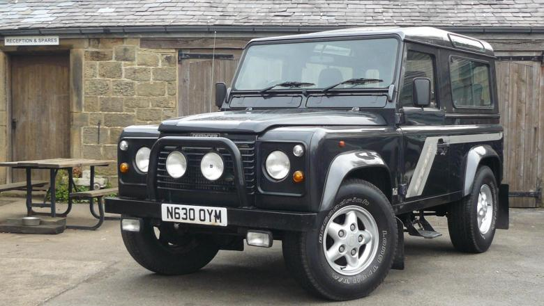 Outside jake wright's land rover workshop is a very nice 300tdi defender county station wagon