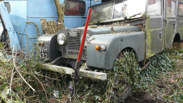 LAND ROVER SERIES ONE in the garden after it was abandoned for 20 years