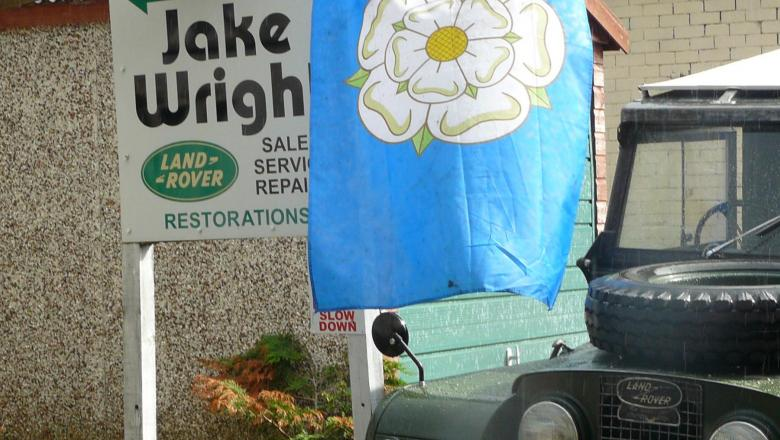 The Yokshire flag is being displayed on August the 1st to Celebrate Yorkshire Day at jake wright's alongside a Series One land rover