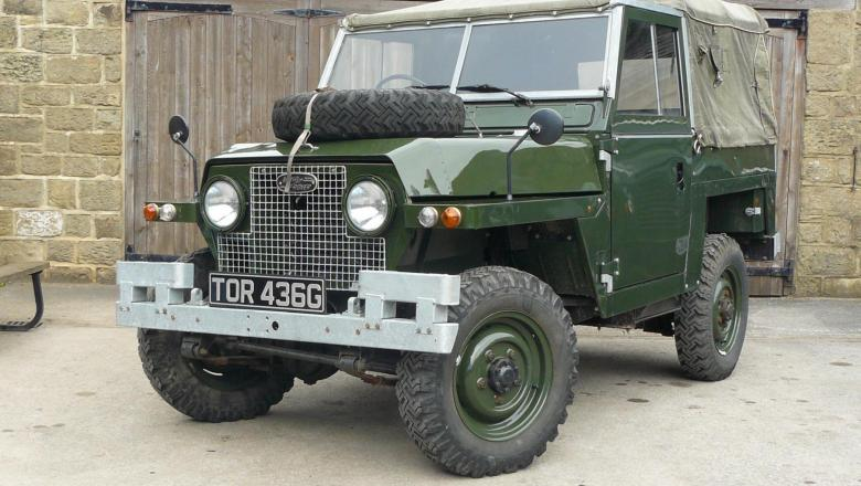 A series 2 land rover lightweight is outside the land rover showroom at jake wright's