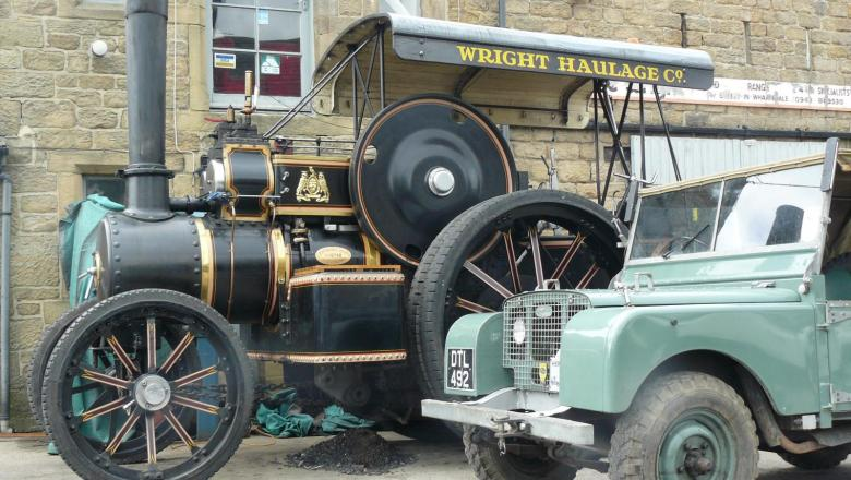 "Land rover 80"" series one next to a Fowler traction engine"