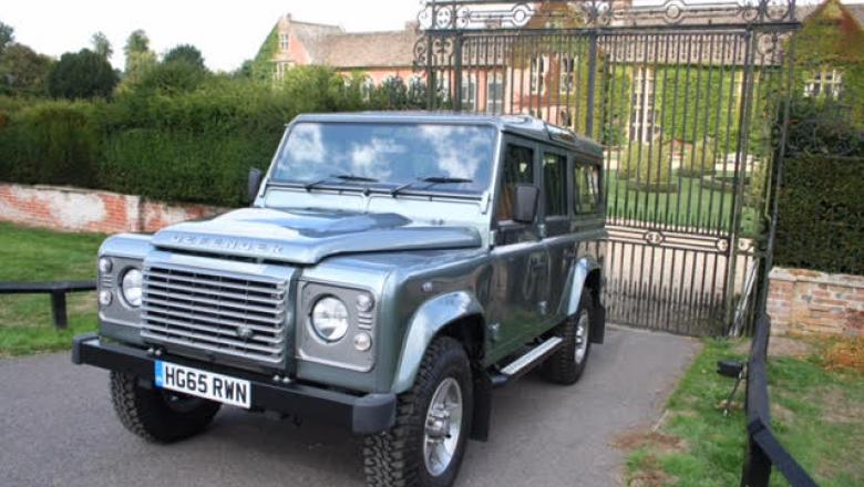 Here is a brand new Land rover defender with only 6 miles on the clock outside a very nice country house