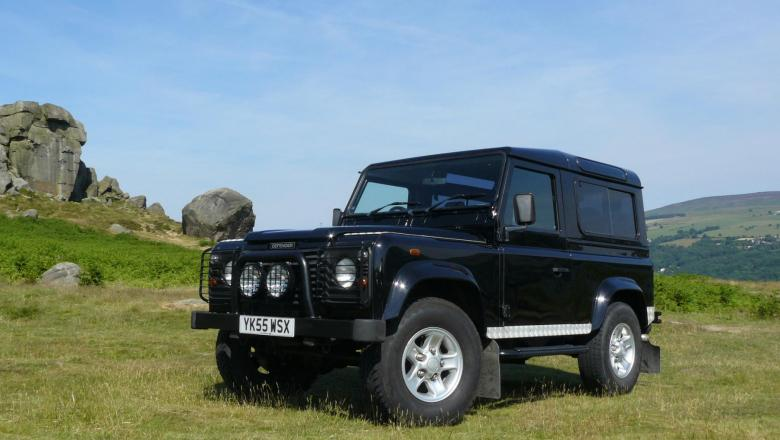 TD5 6 SEATER STATION WAGON 90 DEFENDER IS SHOWN HERE ON ILKLEY MOORS NEAR THE COW AND CALF ROCKS