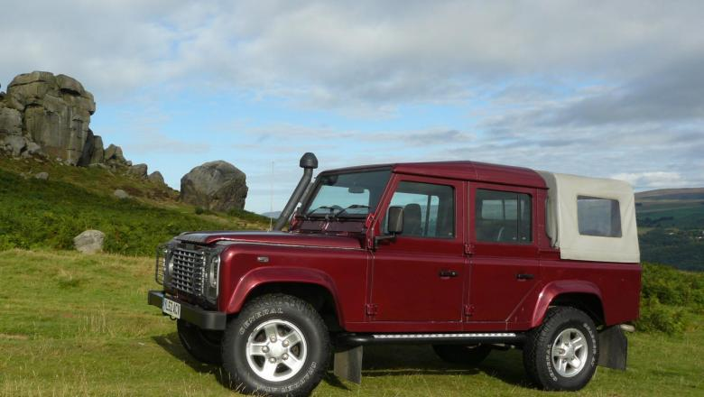 Land rover 110 double cab on ilkley moors near the cow and calf rocks