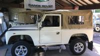 A NICE LAND ROVER DEFENDER IS INSIDE JAKE WRIGHT SHOWROOM