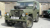 a loveley land rover lightweight is parked outside the workshop at jake wright land rover specialists
